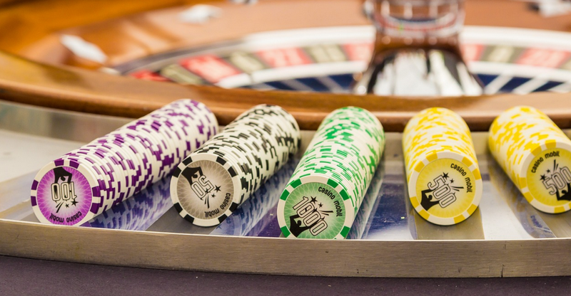 Betting chips in front of roulette wheel